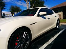 White Lady. Beautiful Pearl White Maserati Royalty Free Stock Photos