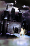 White lady of the castle. Lady riding a horse, like phantoms, at the entrance of a medieval castle Royalty Free Stock Images