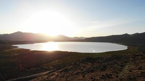 White Lake, Cold Springs, Nevada drone footage. Aerial drone footage over White Lake in Cold Springs, Nevada at sunset stock footage