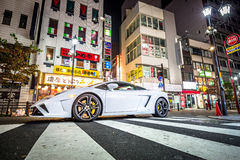White Lamborghini Gallardo on the street of Tokyo, Japan. TOKYO, JAPAN - NOVEMBER 13, 2016: White Lamborghini Gallardo on the street of Ikebukuro district of Royalty Free Stock Photo