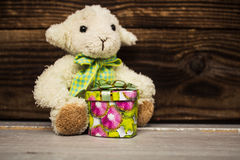 White lamd with little gift box Stock Photography