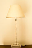 White lamp on the blown table in warm light Stock Photography