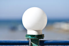 White Lamp in Front of the Red Sea Royalty Free Stock Photos