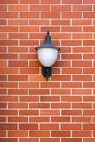White Lamp Red Brick wall Stock Photography
