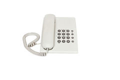 White land line phone. Isolated on a white background Royalty Free Stock Photo
