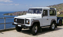 White Land Rover Defender on holiday Royalty Free Stock Image