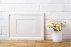White landscape frame mockup with chamomile bouquet in rustic va Royalty Free Stock Images