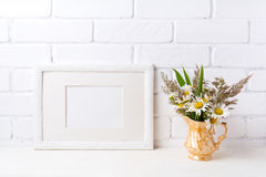 White landscape frame mockup with chamomile and grass in golden stock photos