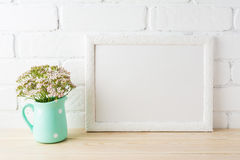White landscape frame mockup with soft pink flowers in pitcher Stock Photo