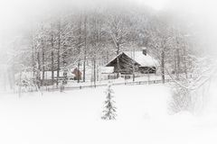 White landscape: snowy house in the woods Royalty Free Stock Image