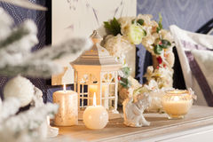 White lantern-candlestick, candles and porcelain angel Stock Photography