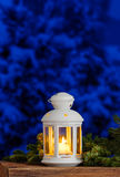 White lantern among fir branches Royalty Free Stock Photo