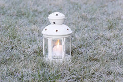 White lantern on frosted grass Royalty Free Stock Photography