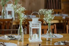 Rustic lantern and babys breath wedding centerpieces stock image