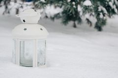 white lantern on the snow against snow-covered branches.Beautiful winter background, copy space stock photos