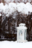 White lantern on snow ground Stock Images