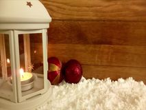 White lantern in the snow, with lighting candle. stock video footage