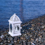 White lantern on the stone coast Stock Photography
