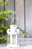 White lantern under fir branch Royalty Free Stock Images