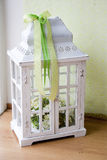 White lanterns. White vintage lanterns with green ribbons. vintage decoration. rustic decoration Stock Photos