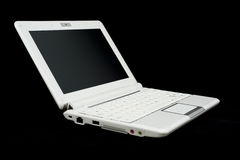 White Laptop. A white laptop computer, isolated on a black studio background Stock Photo