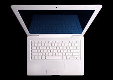 White laptop above. Isolated with clipping path. Stock Photo