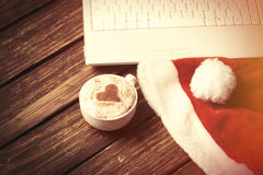 White laptop computer and Santas hat Royalty Free Stock Photography