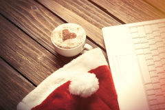 White laptop computer and Santas hat Stock Photography