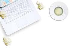White laptop, crumpled paper, espresso, top view Stock Photography