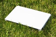 White laptop on the grass Royalty Free Stock Photo