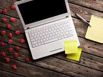 White laptop and hearts with sticky notes Royalty Free Stock Images