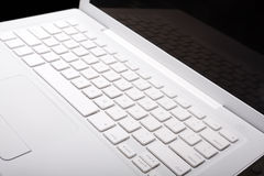 White laptop keyboard. White laptop with keyboard reflection on display Royalty Free Stock Photography