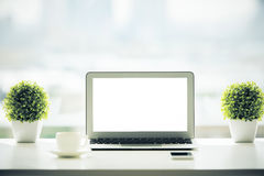 White laptop and other items Royalty Free Stock Images