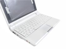 White laptop showing white keyboard from the left. Isolated small new laptop showing white keyboard with white background and clipping path Royalty Free Stock Photo