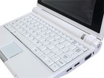 White laptop showing white keyboard from the right. Isolated small new laptop showing white keyboard with white background Royalty Free Stock Image