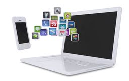 White laptop and smartphone communicate Royalty Free Stock Photography