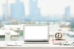 White laptop on table Royalty Free Stock Photography