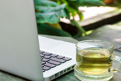 White laptop and tea cup business Royalty Free Stock Images