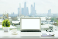 White laptop on windowsill royalty free stock images