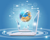 White laptops are connected to network. Earth and Stock Photo