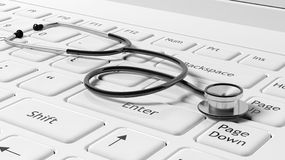 White laptops keyboard with a stethoscope Stock Photo
