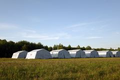 White large army tents. rescue camp. Military base royalty free stock image