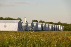 White large army tents. rescue camp. Military base stock image