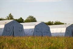 White large army tents. rescue camp. Military base stock images