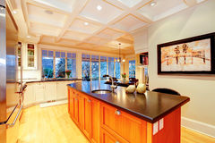 White large luxury kitchen with huge wood island. Royalty Free Stock Photography