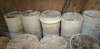 White PVC pipes stacked on floor with concrete stock photos