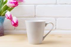 White latte mug mockup with magenta tulip stock photo