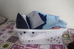 Laundry basket full of fresh linen royalty free stock photos