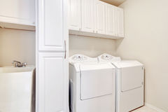White laundry room with washer and dryer. Royalty Free Stock Photo