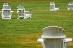 White Lawn Chairs Looking On Royalty Free Stock Photography
